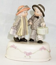 Enesco Music Box Figurine of a Boy and Girl Holding Hands Carrying Gifts - $25.10