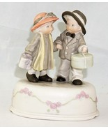 Enesco Music Box Figurine of a Boy and Girl Holding Hands Carrying Gifts - £18.25 GBP