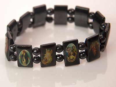Vintage metal religious stretch bracelet with multiple images (item 1a)