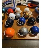 24 vintage NFL mini helmets - $25.99