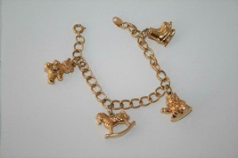 Avon Gold Tone Child's Charm Bracelet Skates, Teddy Bear, Rocking Horse ... - $18.00