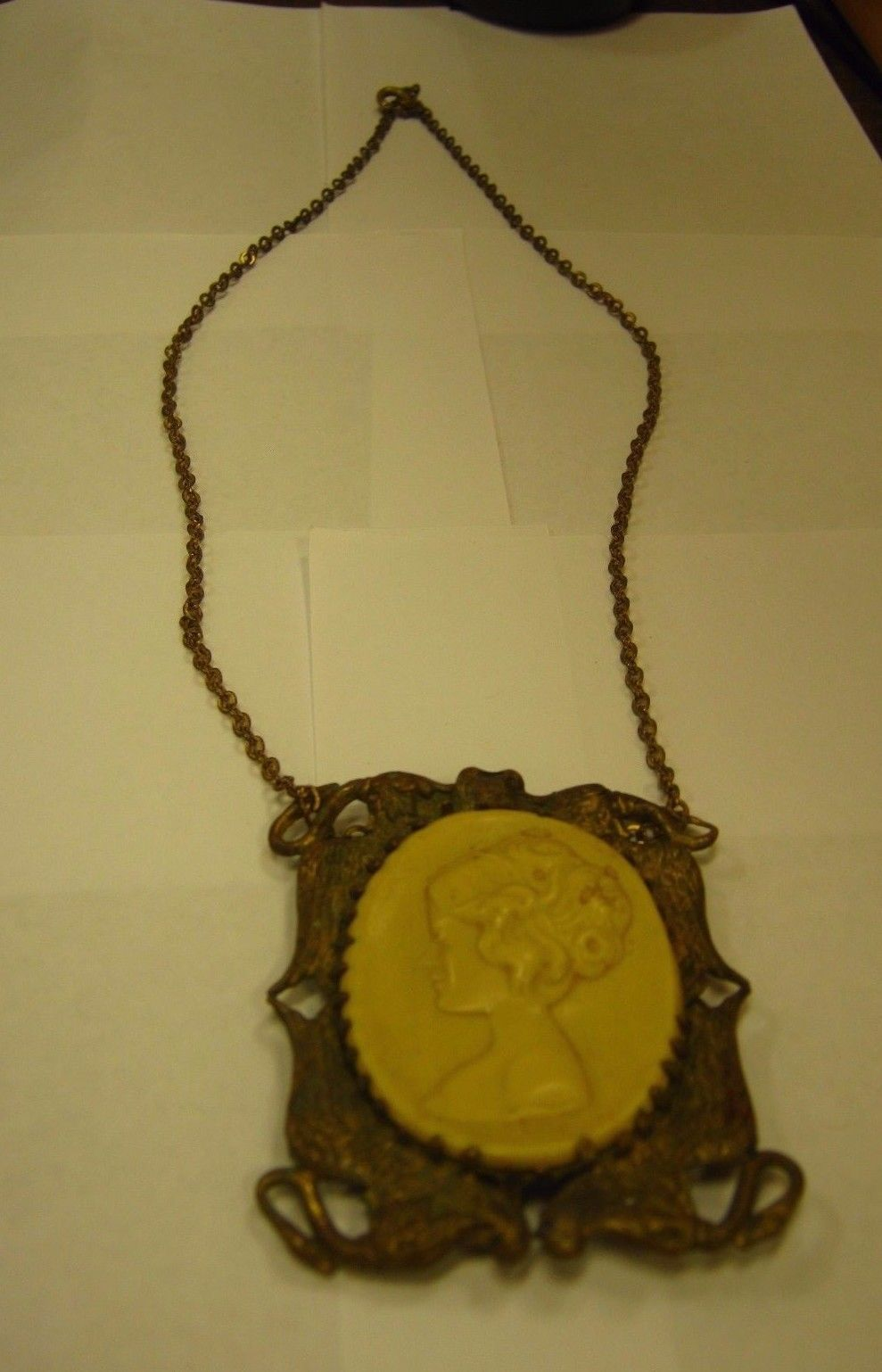 VINTAGE OLD CAMEO IN VINTAGE BRASS SETTING ON CHAIN