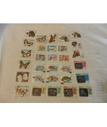 Lot of 30 Mozambique Stamps Dogs, Sports, Butterflies, from 1970s - $22.28