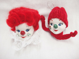 Porcelain Lot 2 Clown Face Ornaments w Yarn Hair and Stocking Hat Red Gr... - $26.72