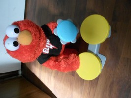 Sesame Street Lets Rock Elmo Animated Singing Plush with Drums & tamborine - $13.79