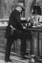 John Wayne in The Shootist iconic pose at saloon bar whisky bottle gun belt 18x2 - $23.99