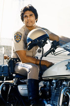 Erik Estrada in CHiPs sitting astride police motorbike 18x24 Poster - $23.99
