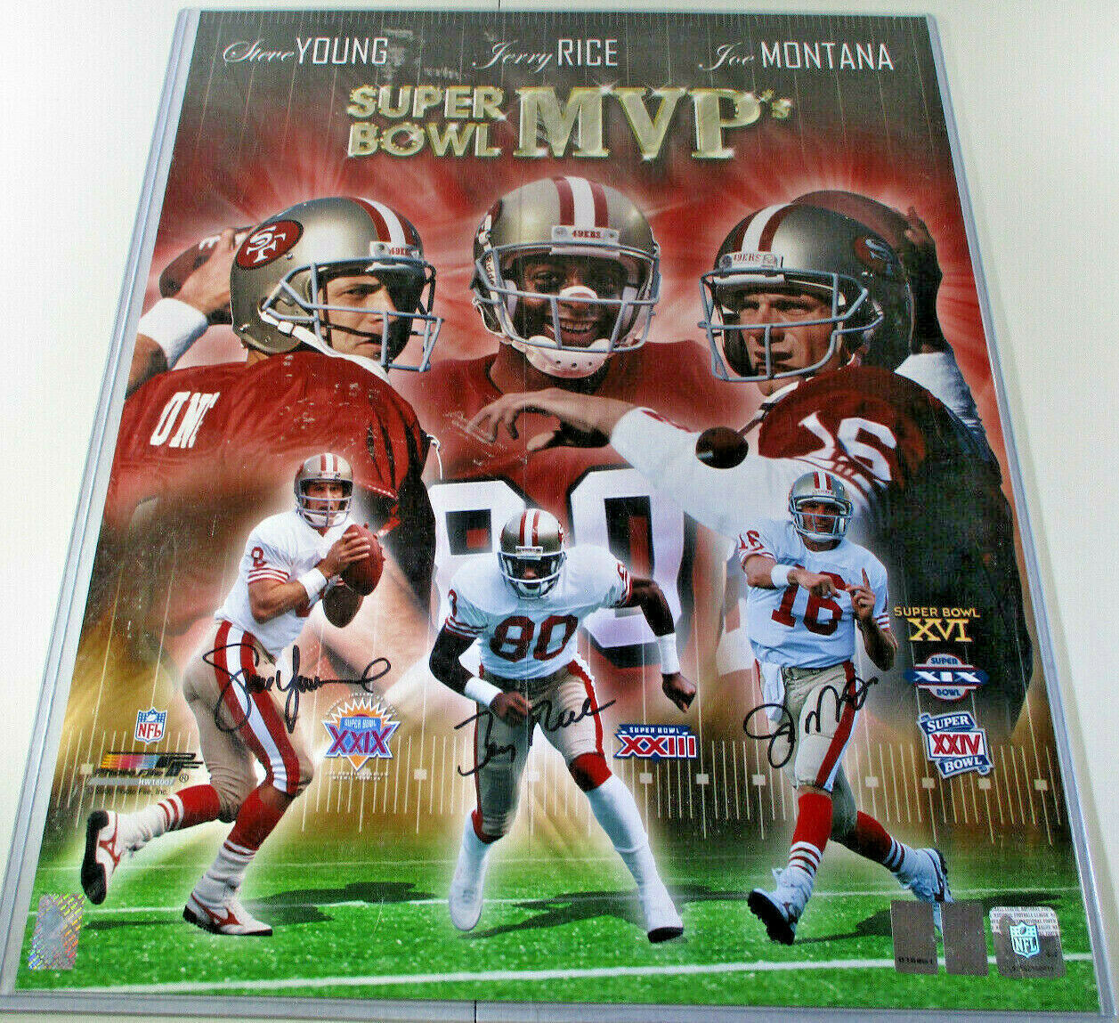 MONTANA, RICE & YOUNG / AUTOGRAPHED 16 X 20 SUPERBOWL MVP PHOTO / PLAYER HOLOS