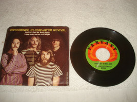 Creedence Clearwater Revival Lookin out my back door/I can see light 45 ... - $19.79