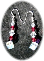 Rainbow of color, Swarovski crystals refract the light in these dangle e... - $39.95