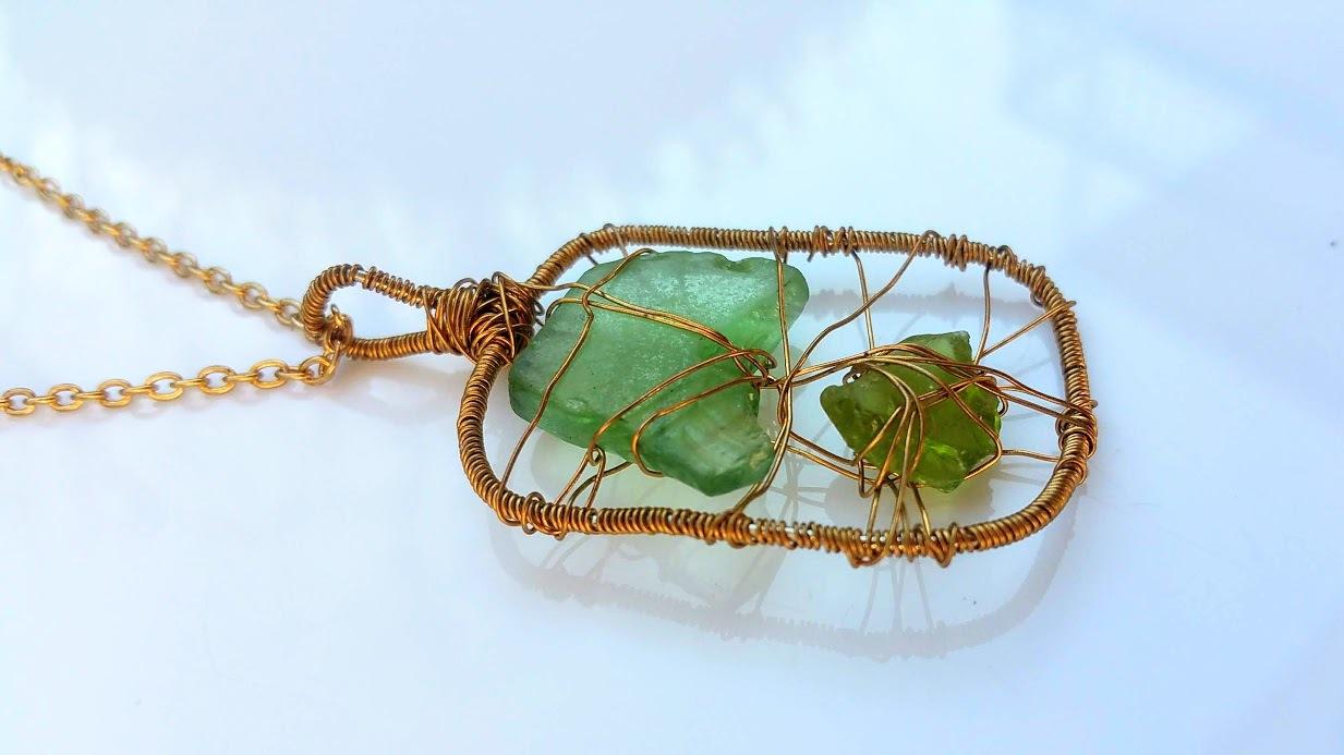 Mermaid's Tangle necklace: Estonian sea glass set in golden wirework pendant