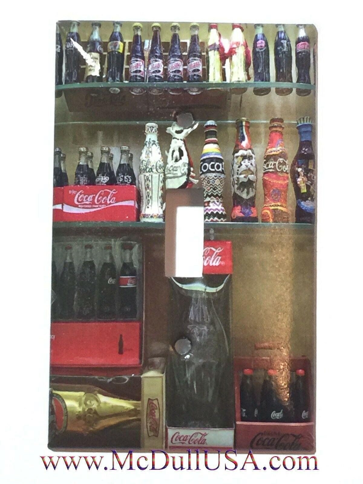 Coke bottle display toggle single