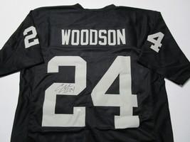CHARLES WOODSON / AUTOGRAPHED OAKLAND RADIERS BLACK CUSTOM FOOTBALL JERSEY / COA image 1