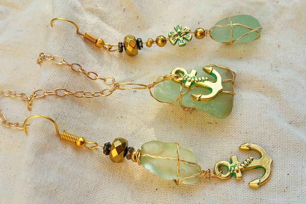 Ever Afloat necklace: blue Hawaiian sea glass set in golden wire & anchor charm