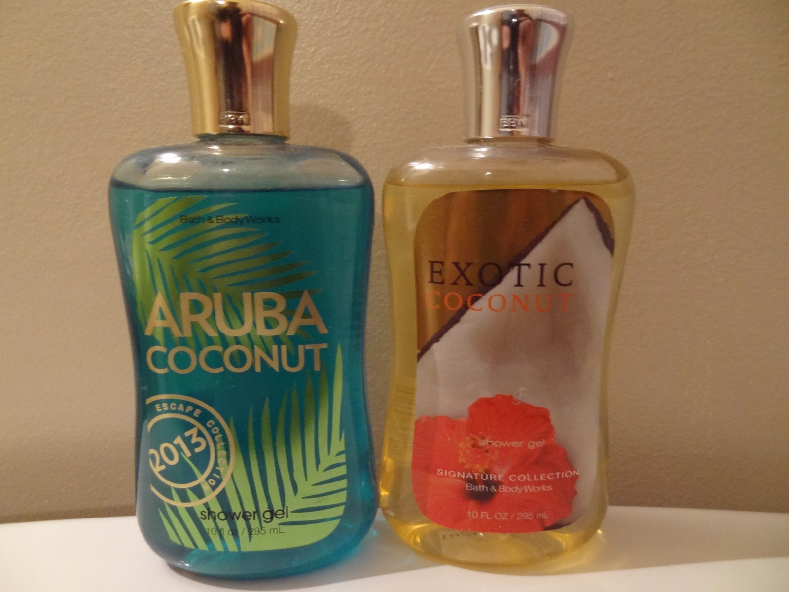 LOT OF 2  BATH & BODY WORKS  ARUBA COCONUT & EXOTIC COCNUT  NEW SHOWER GEL 10 OZ