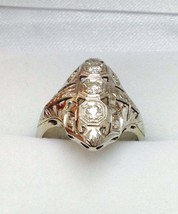 An antique 1/2ct total weight diamond platinum  ring - $850.00