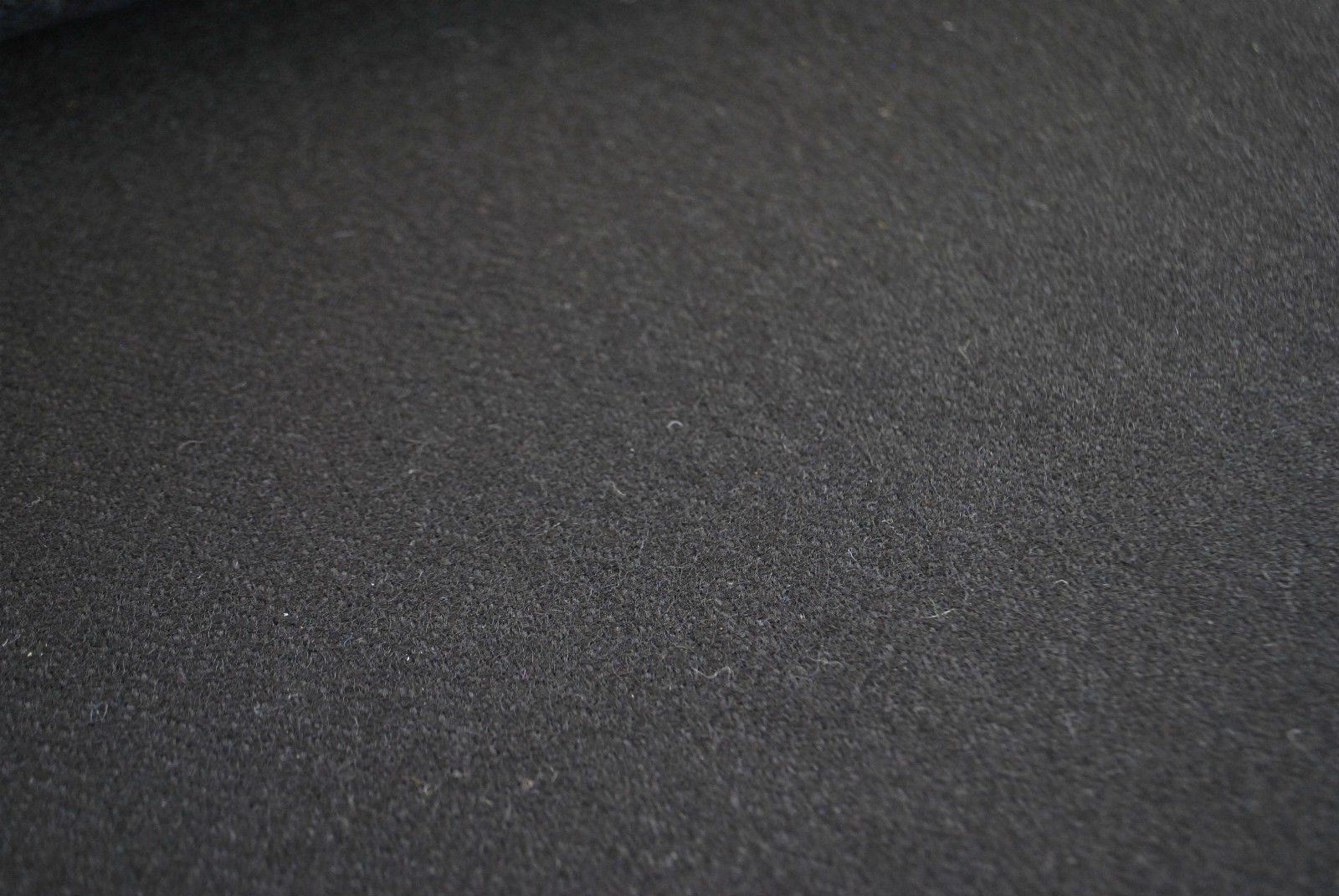 Tweed material by the metre or yard in plain black with Herringbone pattern