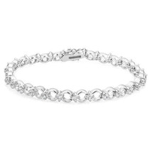 7.25 INCH TENNIS BRACELET WITH ALTERNATING CIRCLES AND ROUND CUT CUBIC Z... - $29.99