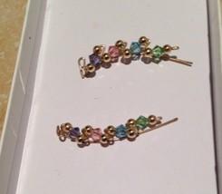 stunning pastel beaded cuff earrings - $48.99
