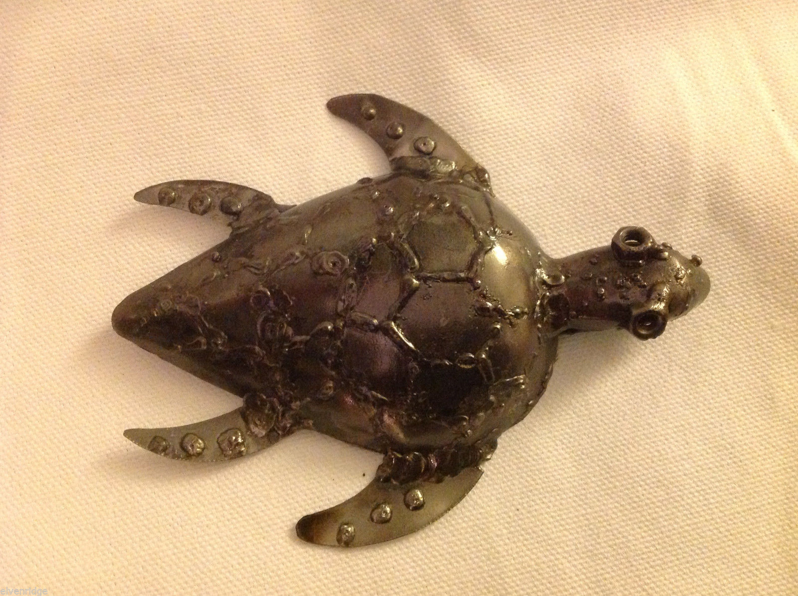Metal scrap sculpture of parts and artifacts sea turtle fair trade global