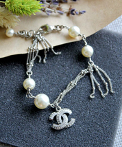Auth CHANEL Supermarket Fishnet Pearl Bracelet With Crystal CC Charm RUNWAY