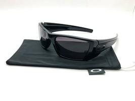 Oakley Sunglasses FUEL CELL Polished Black Frame w/ Warm Grey Lens OO909... - $77.57