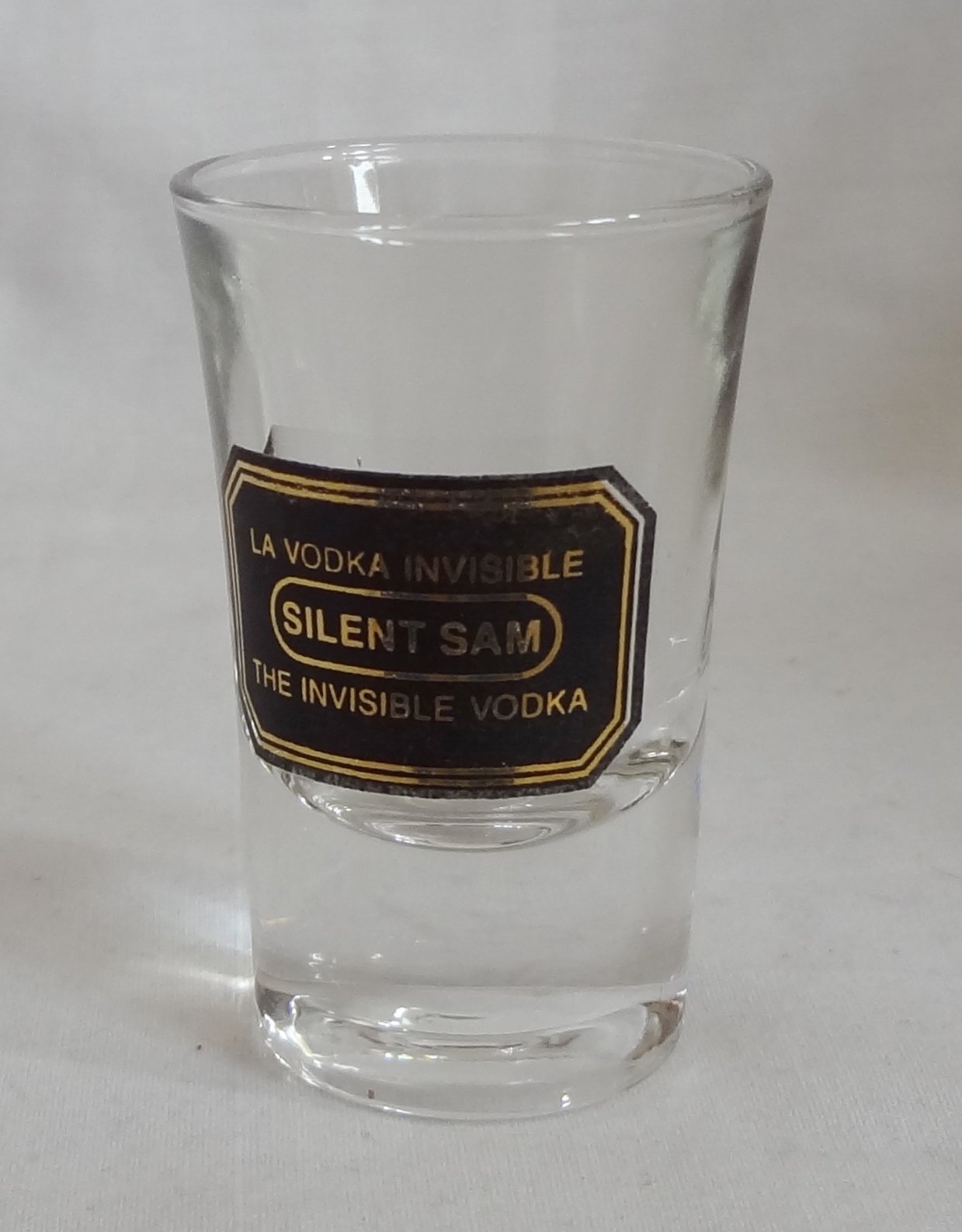 Primary image for Silent Sam The Invisible Vodka 1 oz Shot Glass Barware Black Gold Logo