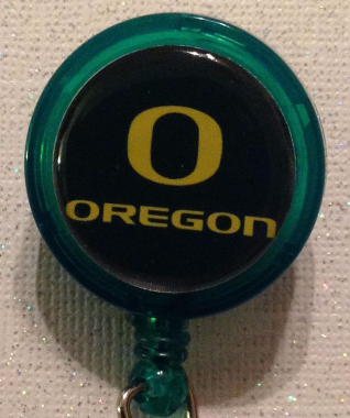 Primary image for Ncaa Oregon Ducks College Badge Reel Id Holder Alligator Clip Green Yellow New