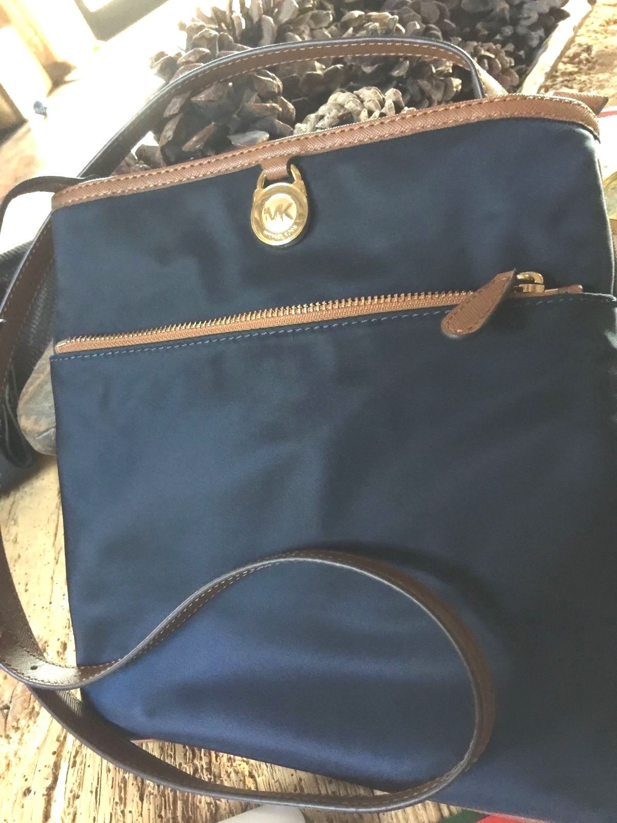 6704821f1948f9 57. 57. Previous. New Michael Kors Kempton Large Pocket Crossbody Bag - Navy/Yellow  Nylon · New Michael Kors Kempton ...