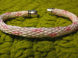 Kumihimo bracelet white satin with pink heart design. Magnetic clasp - $10.00