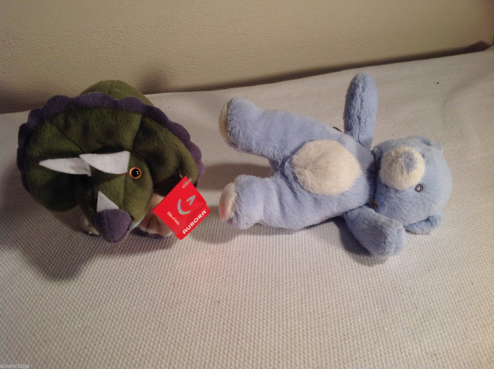 Primary image for 2pc set of Aurora stuffed animals blue bear triceratops rattle roar