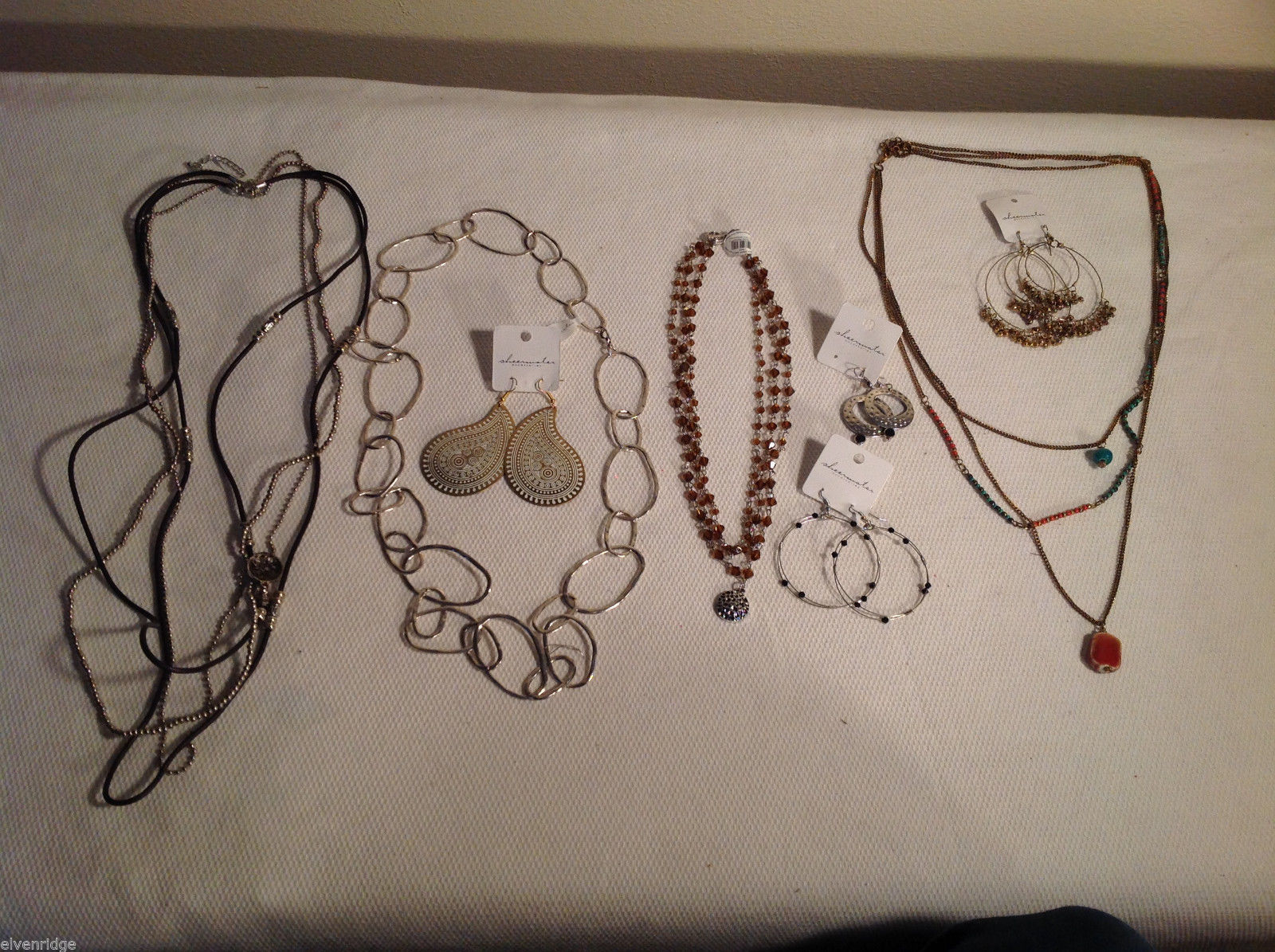 8 piece jewellery lot - 4 necklaces, 4 pairs of earrings silver tone Sheerwater
