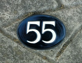 number 55. door sign. Any number oval style plaque. white on black, numbers - $20.28