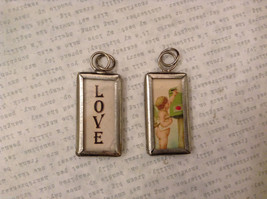 2 sided charm tag in metal frame vintage style - Love / Cupid sending a letter