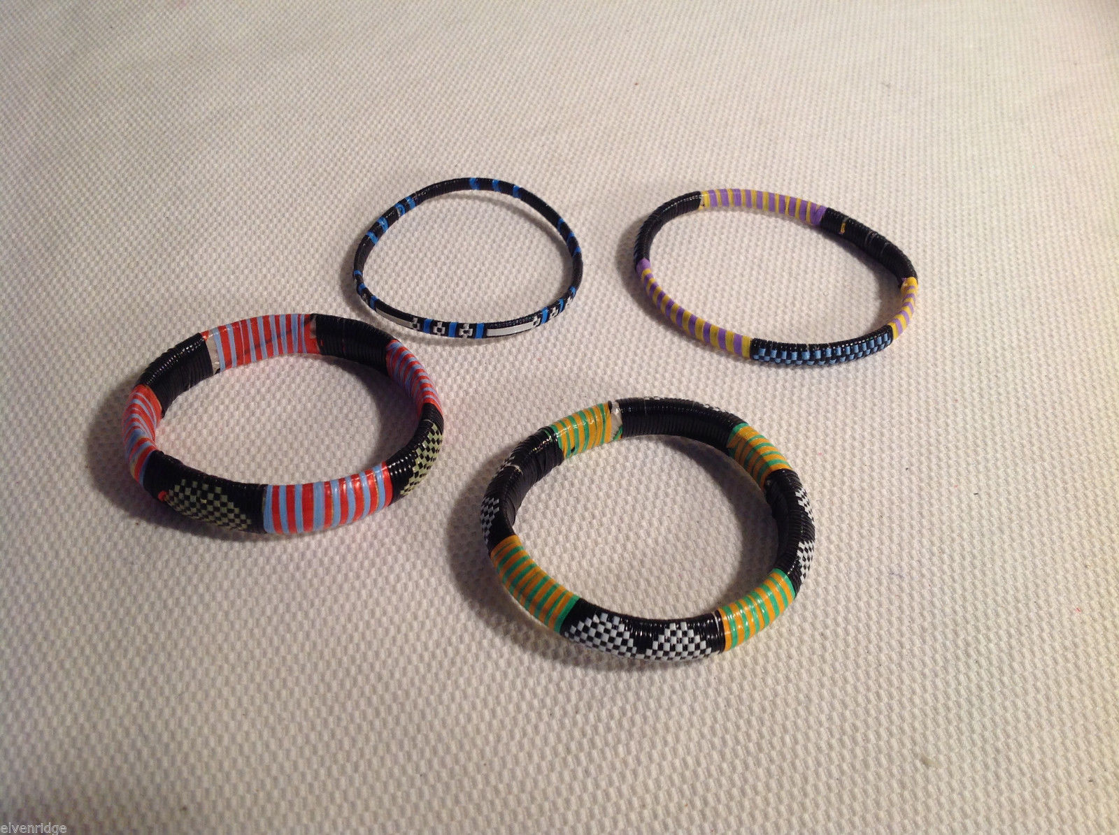 Lot of 4 Plastic woven bracelets handmade multicolor made in Africa