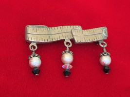 Cute Vintage 1980's to More Mod Sewing Seamstress Measuring Tape Pin Brooch - $6.89