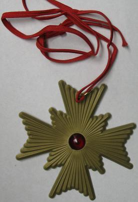 SUPER MEDAL GOLD PLASTIC WITH RED STONE 4 1/4 X 4 1/4 INCHES