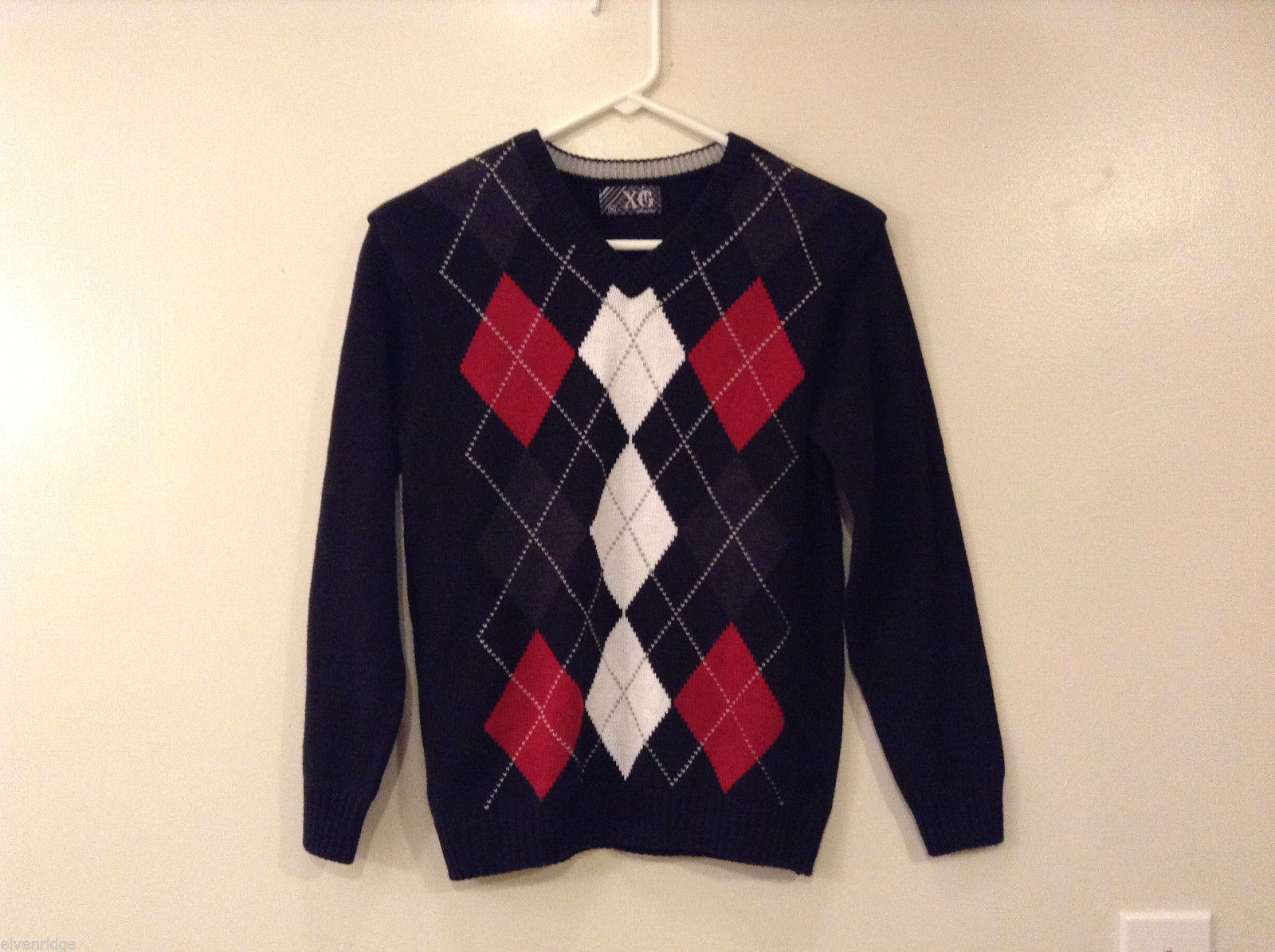 Boy's XG Black Sweater V-Neck Diamont Pattern on front size M (10-12)