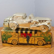 Vintage Avon Solid Gold Cadillac Avon Leather S... - $9.95