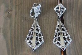 Vintage TRIFARI Silver Tone Dangle Clip Earrings - $9.90
