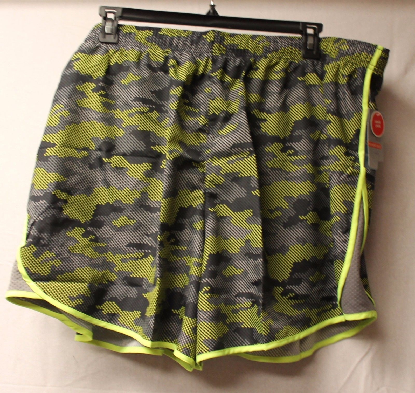 d90c001d813 S l1600. S l1600. Previous. NEW DANSKIN WOMENS PLUS SIZE 4X NEON YELLOW  CAMO WOVEN RUNNING SHORTS W LINER