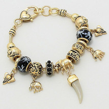 Black & Gold Multi Bead Elephant Horn Heart Charm Bracelet W243369 - $18.75