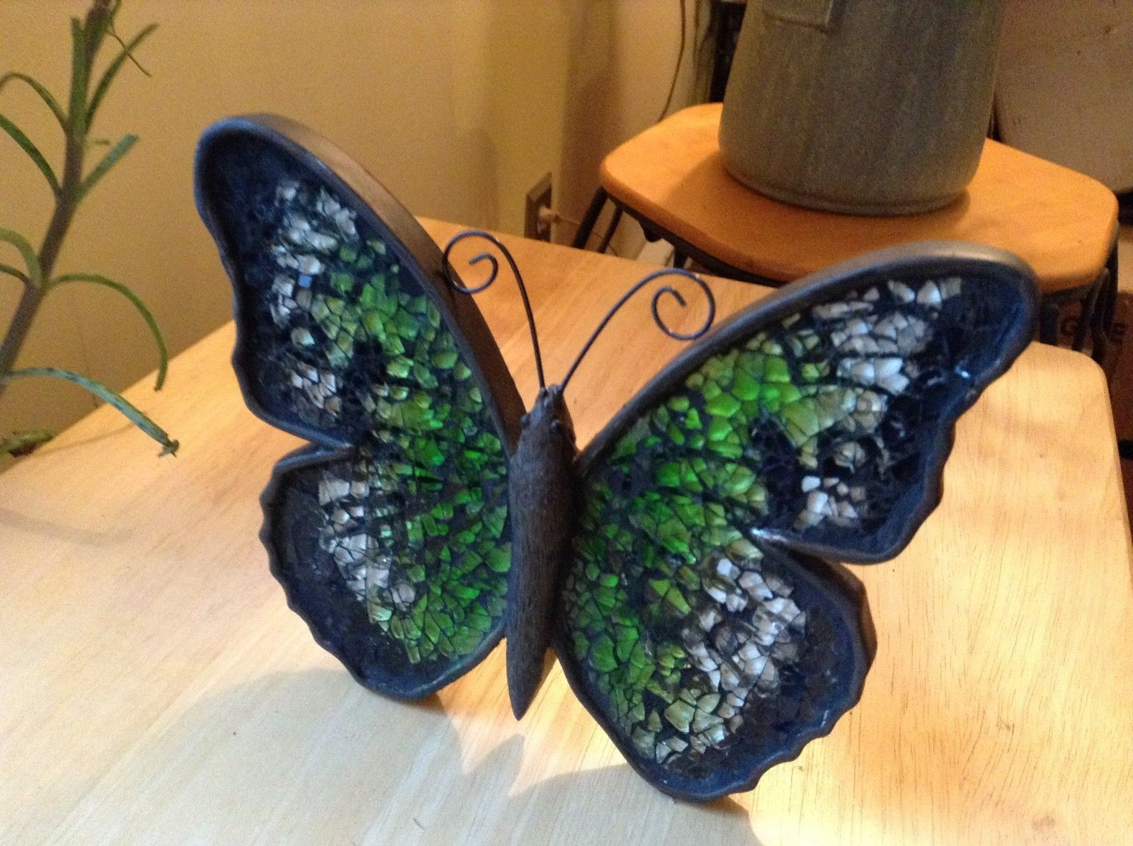 Green mosaic glass and colored standing sparkly butterfly will reflect lights