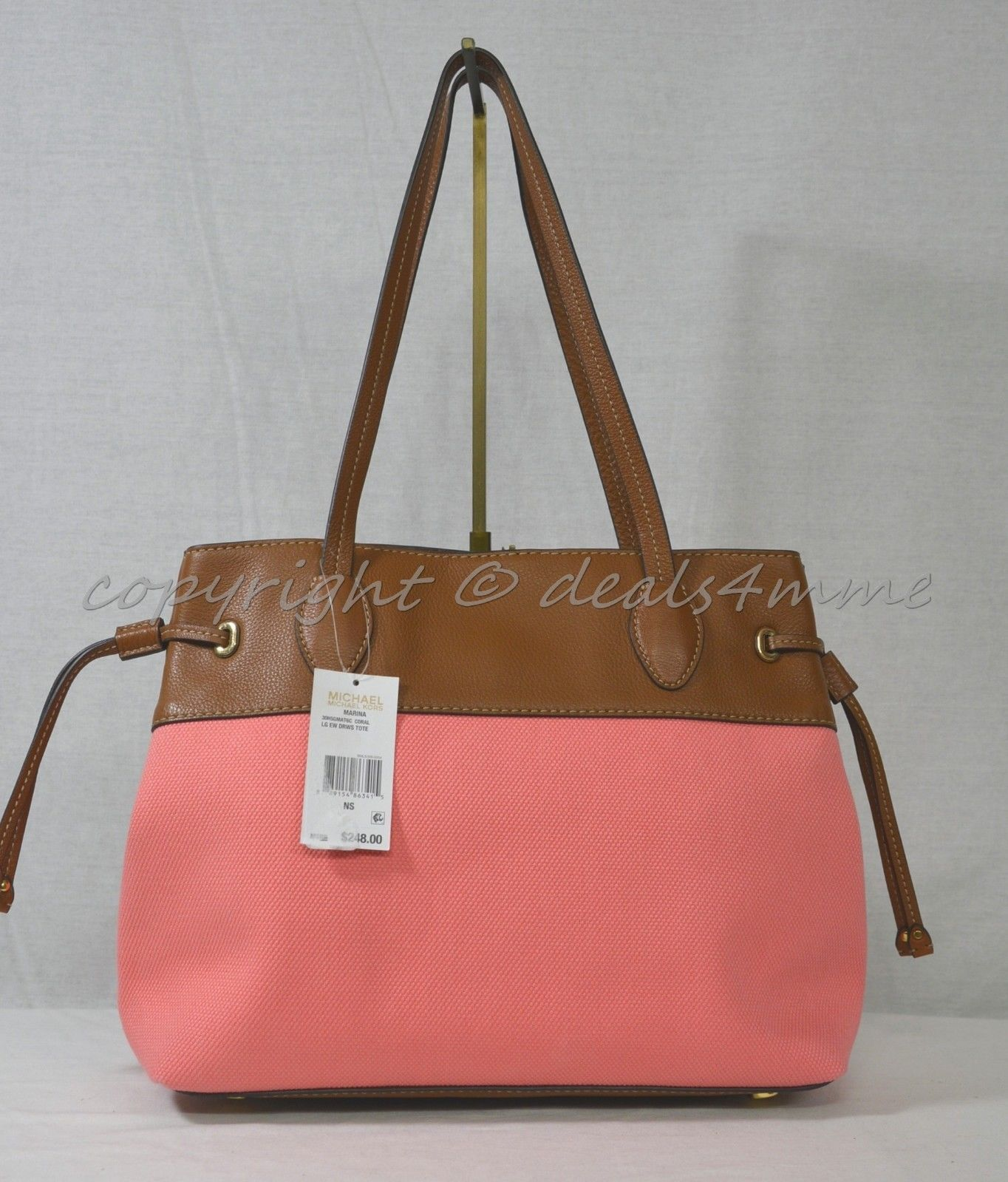 744c37f04848ab Michael Kors Marina East West Drawstring Tote in Coral Canvas & Tan Leather