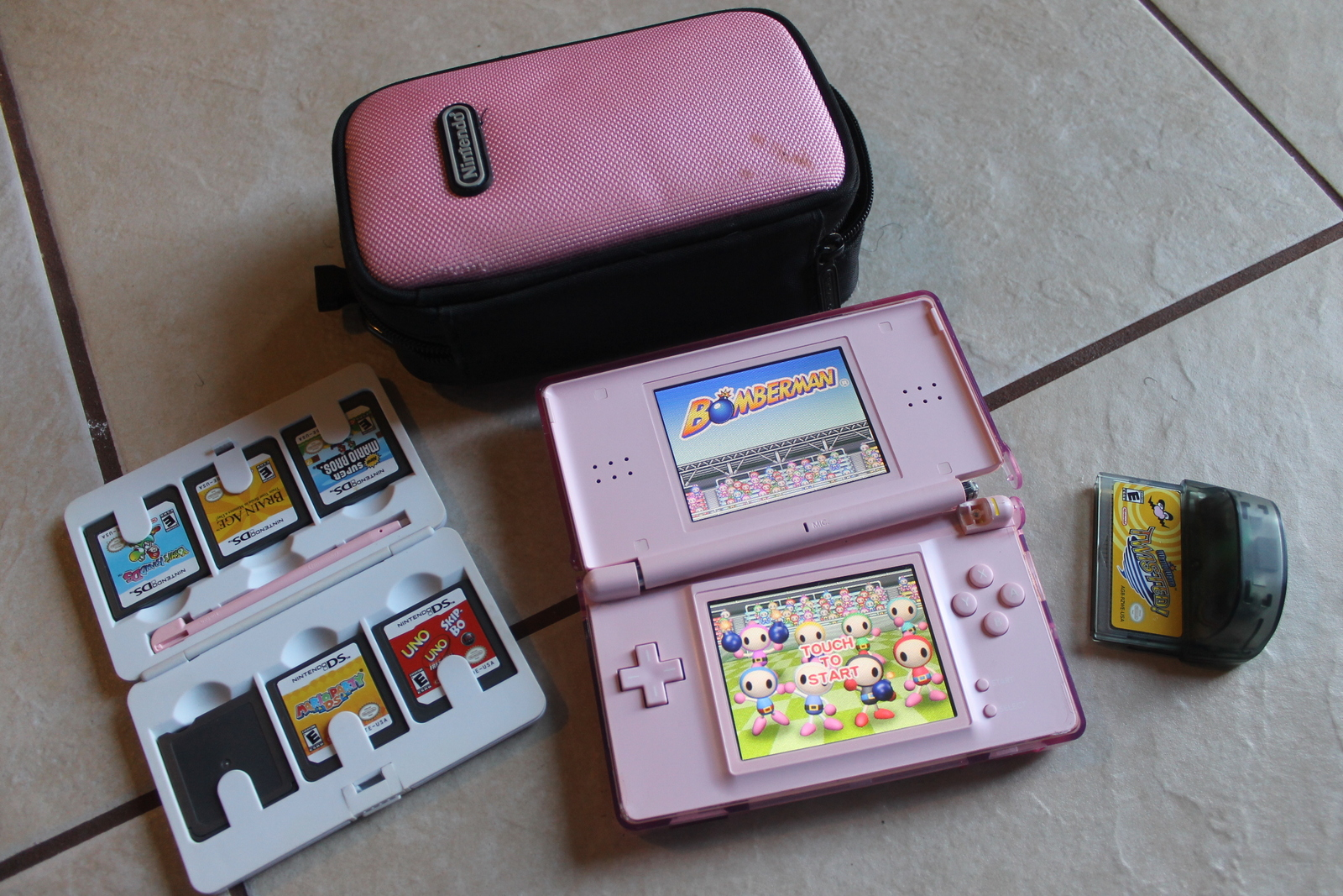 Primary image for Coral Pink Nintendo DS Lite Handheld Console System w 6 Games and case needs fix