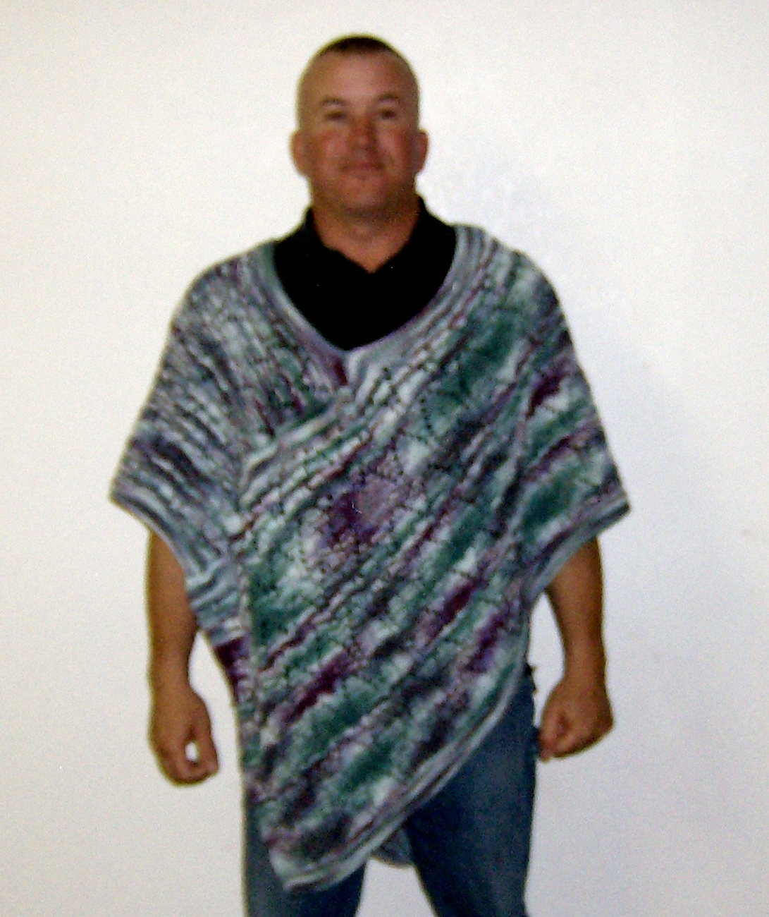 hand knitted arrow head designed poncho in pagentry color