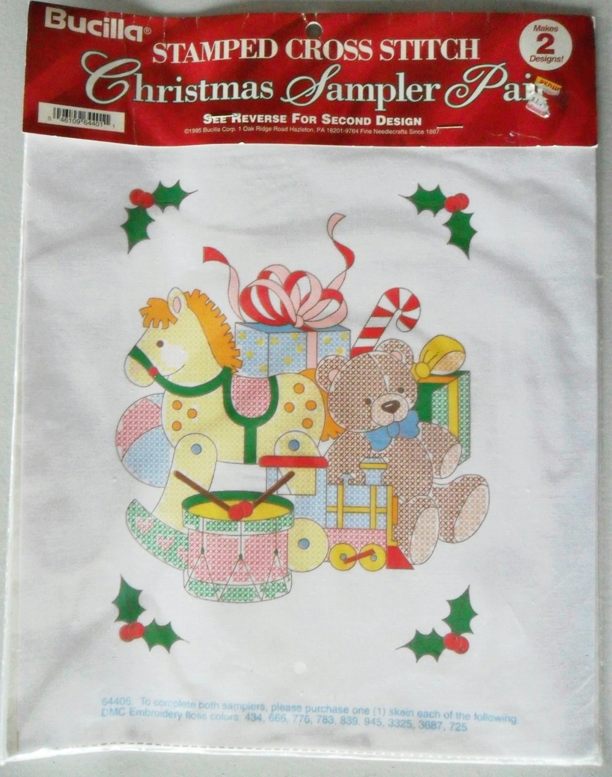 Bucilla Stamped Cross Stitch Christmas Sampler Pair Toys Stocking NIP 1995 - $4.00