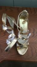 Gold Michael Kors platform heels - $125.00