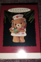 HALLMARK KEEPSAKE CHRISTMAS ORNAMENT CARING NURSE  - $7.00