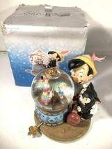 Rare Disney Pinocchio and Figaro Magic Musical Animated Snow Globe Brahm... - $173.24